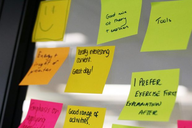 Post-it notes on a wall showing feedback including 'really interesting content - great day!'