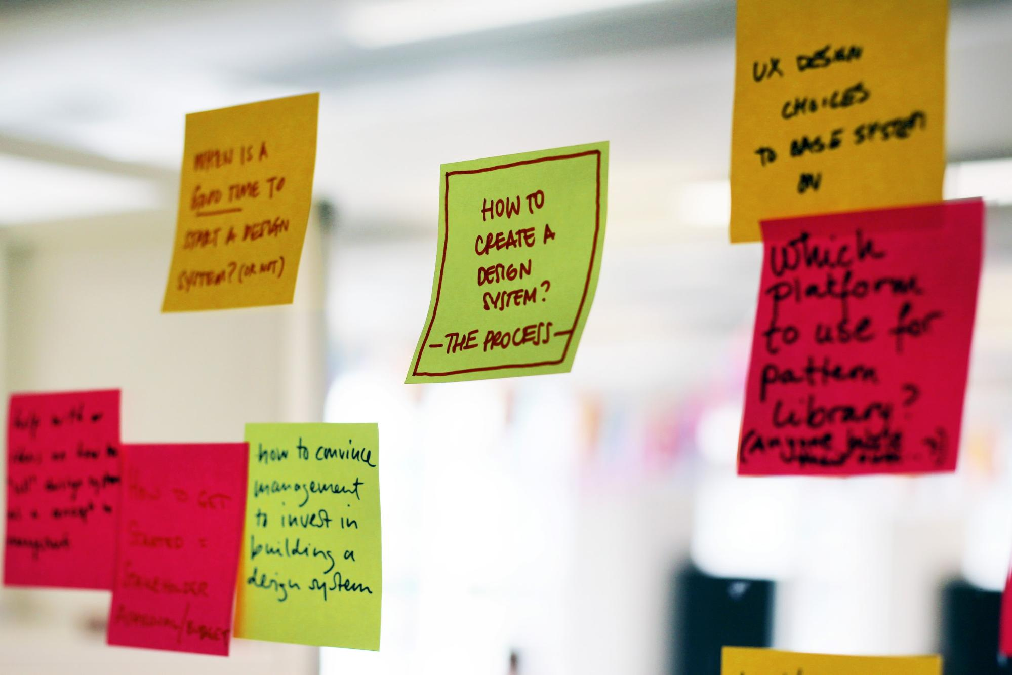 A series of Post-it notes - one of which reads: 'How to create a design system?' - process