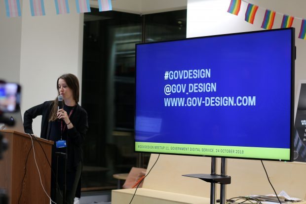 an image of a presenter with a microphone and a screen saying '#GOVDESIGN, @GOV_DESIGN, WWW.GOVDESIGN.COM'