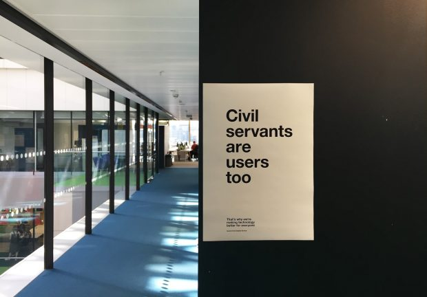 A poster on a wall in the GDS office saying 'Civil servants are users too'.