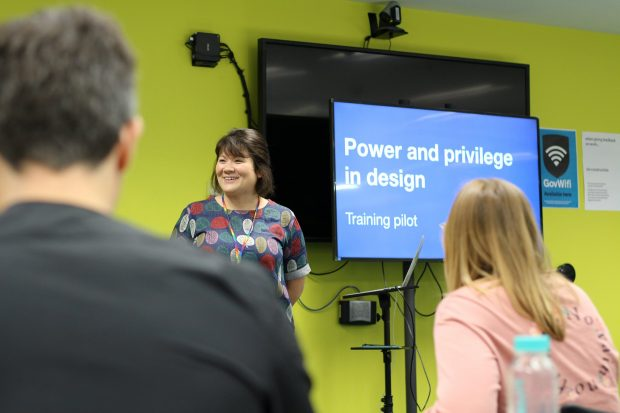 Design trainer Clara Greo standing in front of participants of the new Power and Privilege training at the Government Digital Service