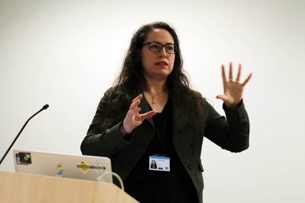 Nikola Goger, design lead at the Ministry of Justice, standing behind a lectern while speaking at a cross-government design meetup in London in early 2020