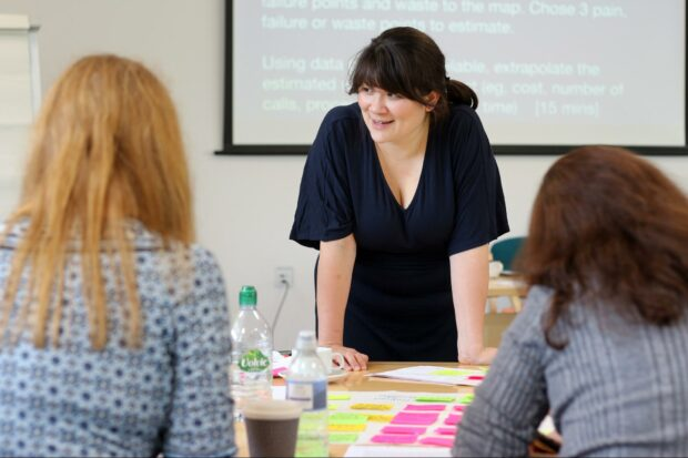 Design trainer Clara Greo in conversation with people attending training